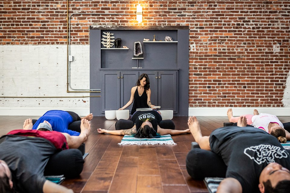 A yoga teacher with students
